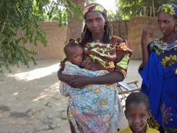 African woman breastfeeding baby