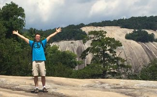 Alex Schenker hiking Stone Mountain, NC