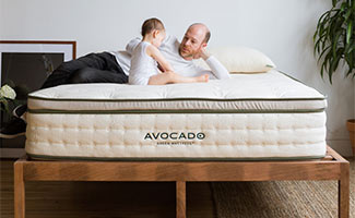 Man and baby on Avacado Green mattress