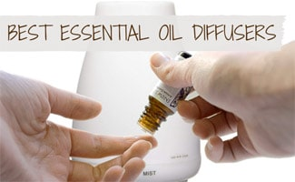Essential oil being applied ot finger in front of diffuser