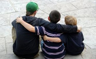Boys hugging