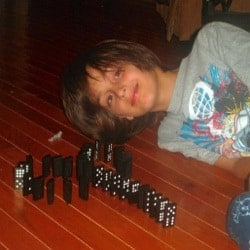 Kid playing with dominos