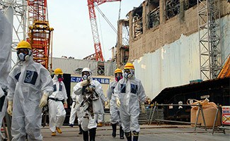 Fukushima Nuclear Plant with people walking