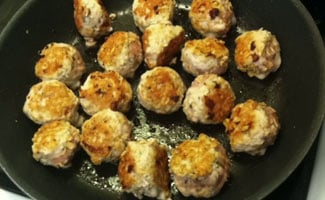 Meatballs cooking in frying pan
