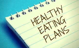 Healthy eating plan written on notebook