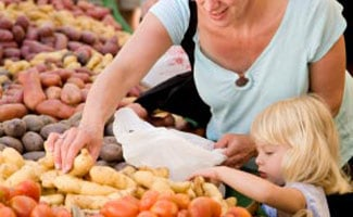 Mother and kid at farmer's market
