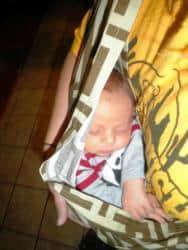 Newborn in baby carrier