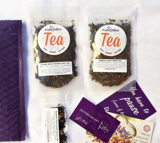 Plum Deluxe Tea Of The Month Club box items spread out