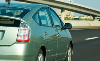 Toyota Prius driving on the road