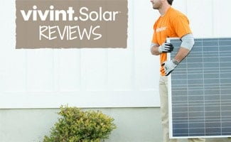Man carrying solar panel: Vivint Solar Reviews