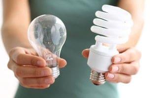 Woman holdling light bulbs